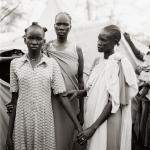 Fazal Sheikh, Akuot Nyibol (pregnant at center) with Riak Warabek and Akuot's daughter, Athok Duom, who is recovering from malaria, Sudanese refugee camp, Lokichoggio, Kenya, 1992, Yale University Art Gallery